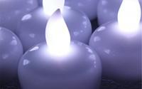 Flameless-Led-Candles-65292-agptek-12-piece-Flameless-Waterproof-Floating-Tealight-Cool-White6.jpg